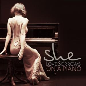 She: Love Sorrows on a Piano